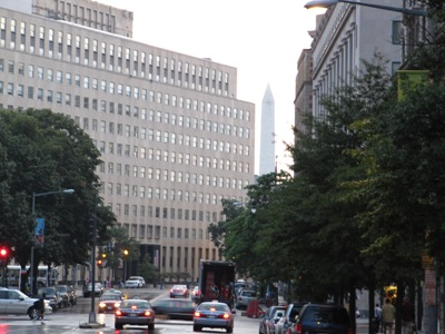 The Washington Monument peeking out from behind the Export-Import Bank and Dana buildings, L Street NW, looking south on 15th Street, Washington, D.C., 21 August 2009