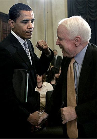 Barack Obama and John McCain horsing around in committee